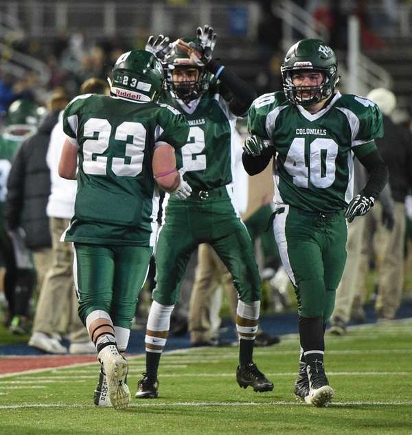 William Floyd running back Nick Silva, left, celebrates