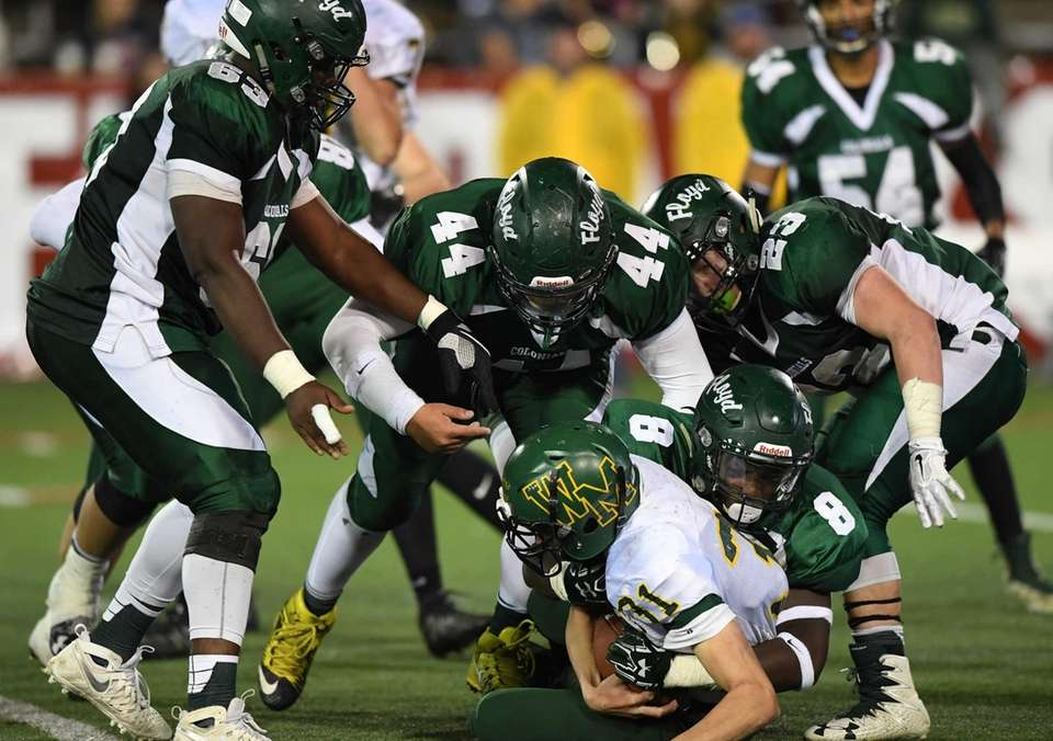 William Floyd's defense including Keith Winfrey (8) takes