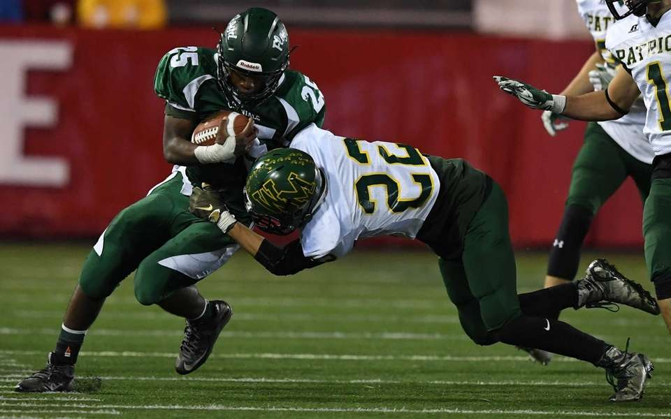William Floyd's James Taitt is tackled by Ward