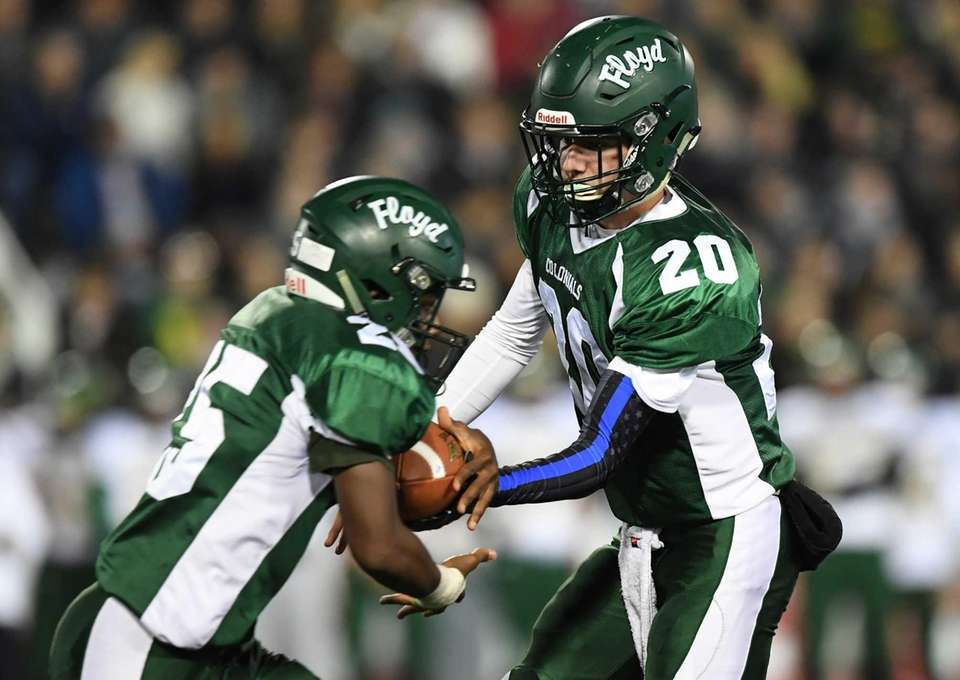 William Floyd quarterback Robert Taiani hands the ball
