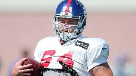 New York Giants center Shane McDermott runs with