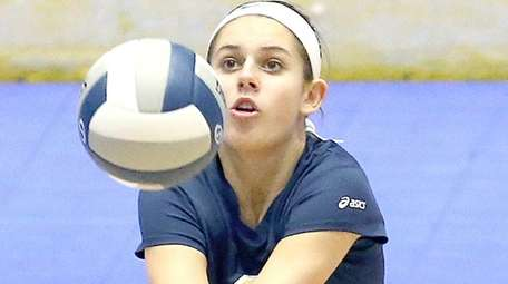 Bayport-Blue Point's Olivia Kane gets the high dig