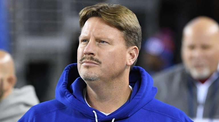 New York Giants head coach Ben McAdoo enters
