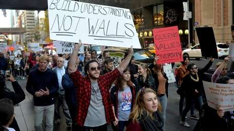 Several hundred people march along 57th Street in