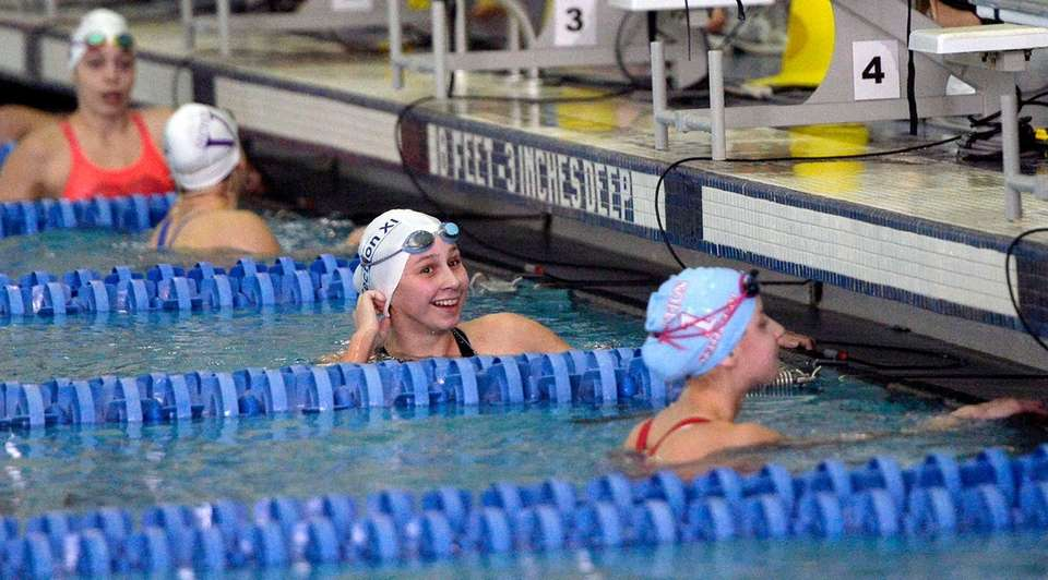 Northport's Chloe Stepanek checks her time in the