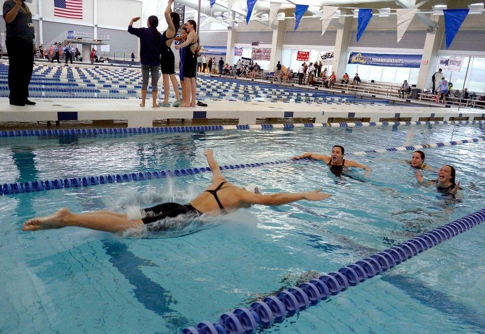 Long Beach's Kristen Romano and teammates celebrate a