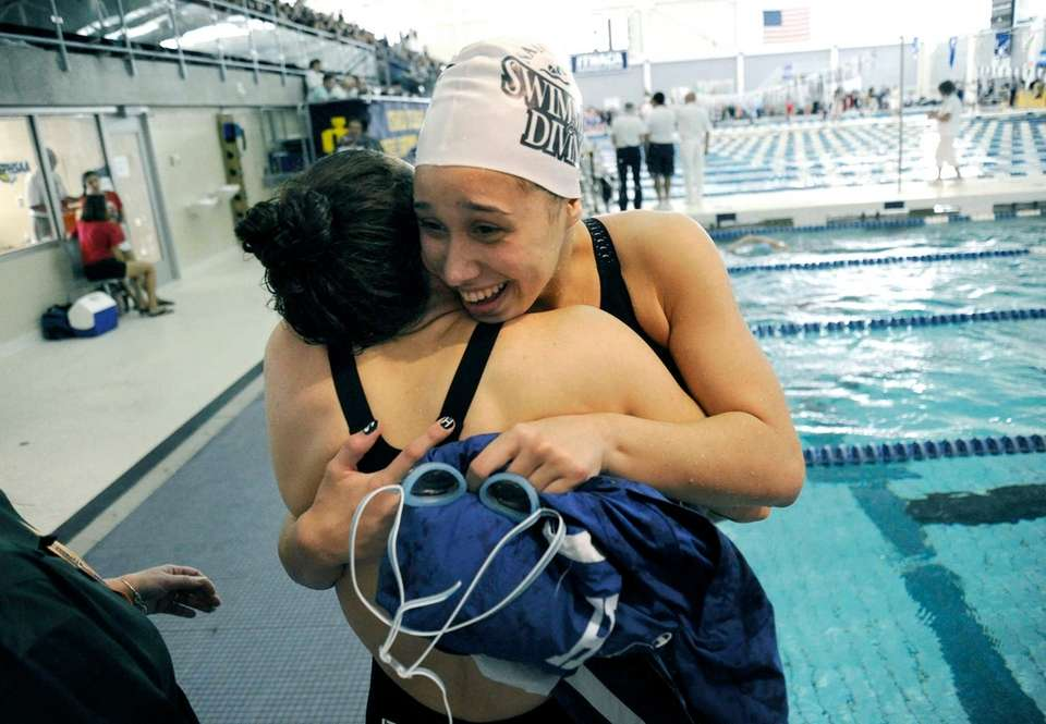 Long Beach's Kristen Romano, facing, is congratulated on