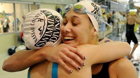 Long Beach's Kristen Romano is congratulated on her