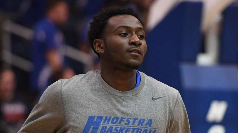 Hofstra forward Ty Greer warms up before an