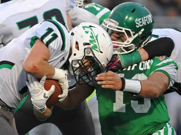 John DeRidder #11 of Carle Place-Wheatley, left, rushes