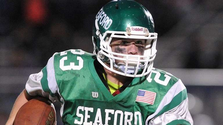 Danny Roell #23 of Seaford rushes for a