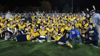 Shoreham Wading River players and coaches celebrate their