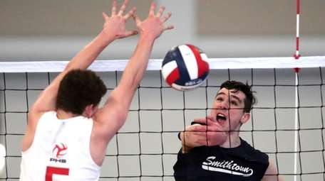 Smithtown West's Chris Shanley (4) spikes the ball