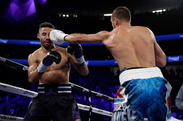 Sergey Kovalev, right, of Russia, punches Andre Ward