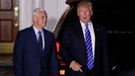 President-elect Donald Trump walks with Vice President-elect Mike