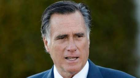 Mitt Romney talks to media after meeting with
