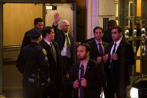 Vice President-elect Mike Pence, top center, leaves the