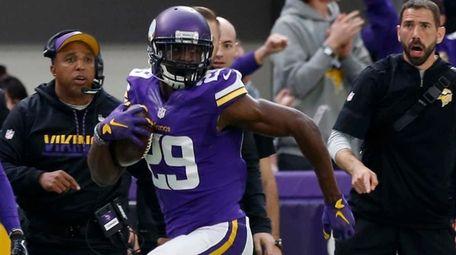 Minnesota Vikings cornerback Xavier Rhodes returns an interception
