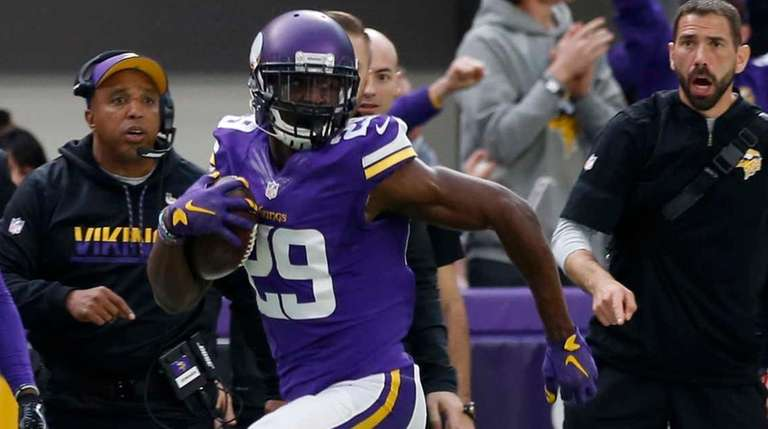 Minnesota Vikings cornerback Xavier Rhodes returns an interception