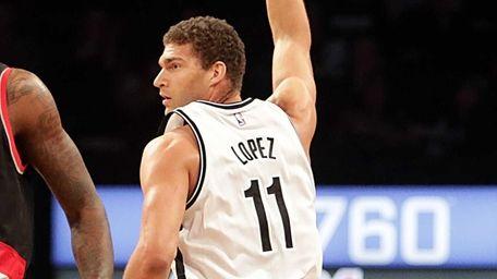 Brooklyn Nets center Brook Lopez (11) signals a