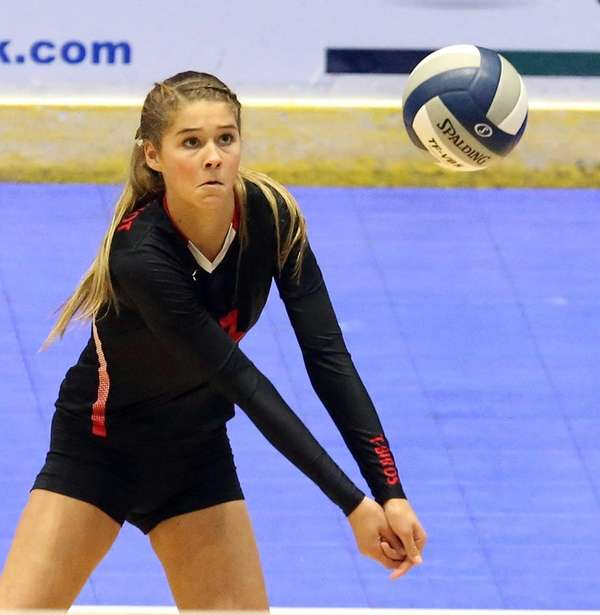 Connetquot's Mackenzie Cole bumps the ball during the
