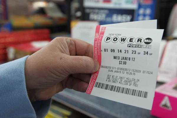 Lorraine Trotta of Lindenhurst buys a Powerball ticket