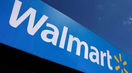 A Walmart logo is displayed in Springfield, Ill.,