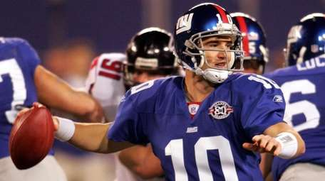 Eli Manning throws a pass in the first