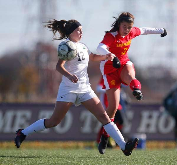 Sacred Heart Academy's Victoria Minda kicks the ball