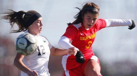 Sacred Heart Academy's Victoria Minda kicks the ball