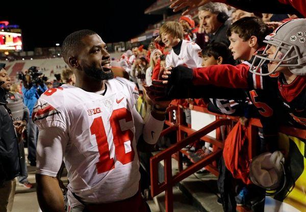 Ohio State quarterback J.T. Barrett greets fans after