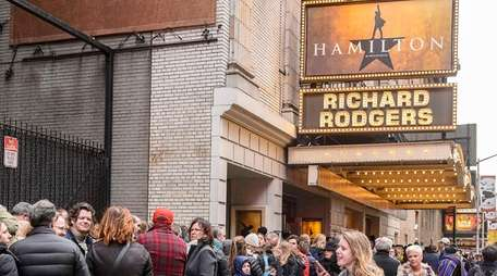 Theater goers queue up to enter the Richard