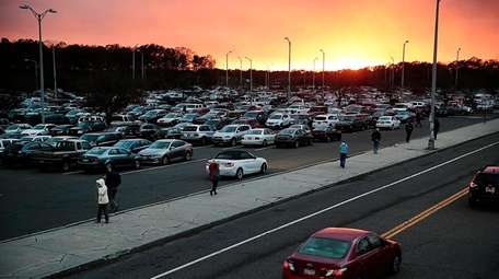 Commuters return to their cars in the crowded
