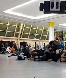 Passengers duck for cover at immigration control as