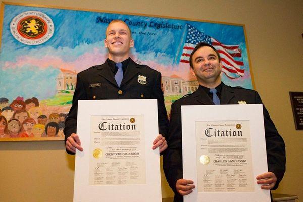 Nassau Police officers Christopher According and Charles Samolinski,
