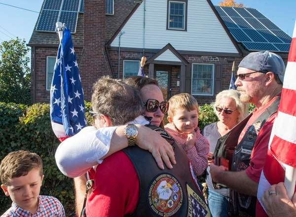 Eileen Howell gets a hug from a Patriot
