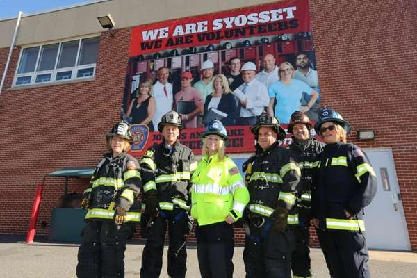 From left, Syosset firefighters Rachel Share, Pete Silver,