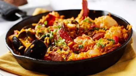 The seafood paella, filled with lobster, shrimp, scallops,