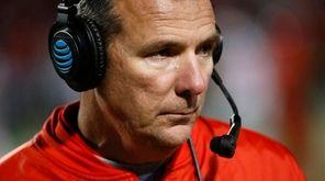 Ohio State head coach Urban Meyer walks on