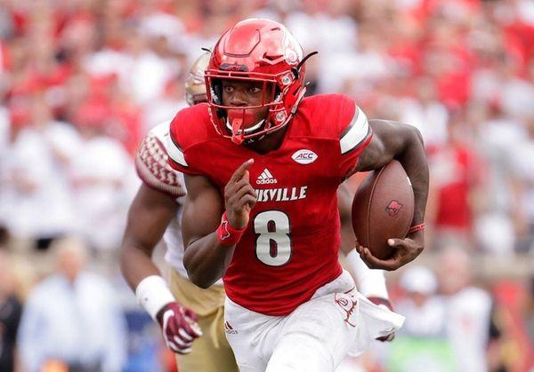 Lamar Jackson of the Louisville Cardinals runs for