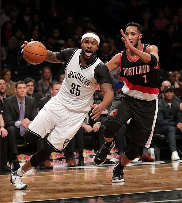 Brooklyn Nets forward Trevor Booker drives the baseline
