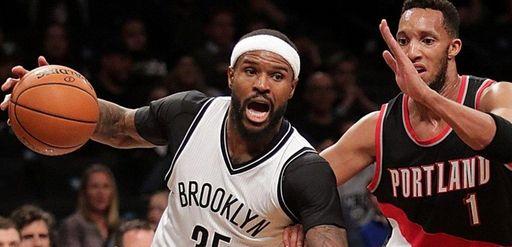 Brooklyn Nets forward Trevor Booker drives the baseline