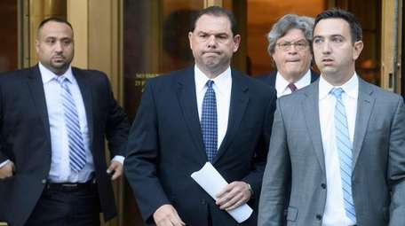 Joseph Percoco, second from left, leaving federal court