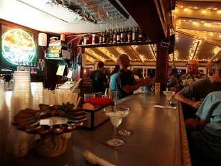 Customers sit in the bar area at JT's