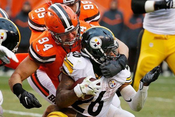 Browns defensive end Carl Nassib wraps up Pittsburgh