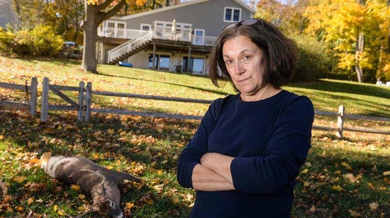 Cindy Gavel of Asharoken, stands near a hunted