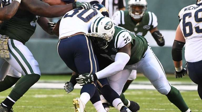 New York Jets defensive end Muhammad Wilkerson tackles