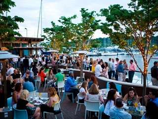 Patrons enjoy drinks and conversation at the outdoor