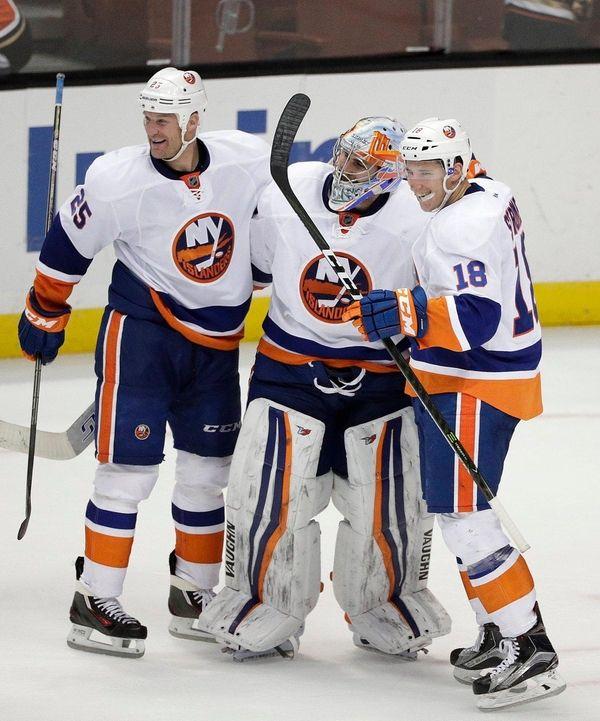New York Islanders' Jason Chimera; goalie Thomas Greiss,