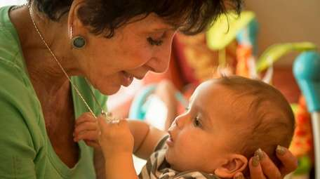 Liz McGeary, with her adopted grandson, Gabe Glassing,